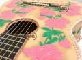 Chitarra rivestita in cuoio fatta a mano con cucitura a treccia